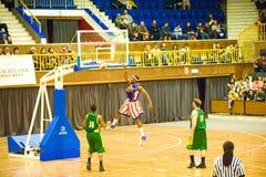 Harlem Globetrotters basketball team. BUCHAREST - MARCH 26: The world famous Harlem Globetrotters basketball team in an exhibition match against Washington Stock Image