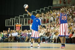 Harlem Globetrotters basketball team in an exhibit. The world famous Harlem Globetrotters basketball team in an exhibition match against Washington Generals at Stock Photo