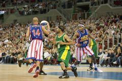 Harlem Globetrotters basketball team in an exhibit. The world famous Harlem Globetrotters basketball team in an exhibition match against Washington Generals at Royalty Free Stock Image