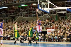 Harlem Globetrotters basketball team in an exhibit. The world famous Harlem Globetrotters basketball team in an exhibition match against Washington Generals at Royalty Free Stock Photography