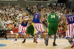 Harlem Globetrotters basketball team in an exhibit. The world famous Harlem Globetrotters basketball team in an exhibition match against Washington Generals at Stock Images