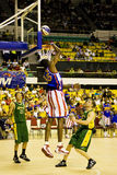 Harlem Globetrotters World Tour. Image of Skyscraper Alleyne of the world famous Harlem Globetrotters basketball team in action against Washington Generals held Royalty Free Stock Photo