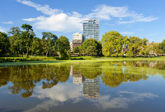 Harlem Meer in the Summer. Harlem Meer's trees and are reflected in the waters on a Summer Day Stock Photography