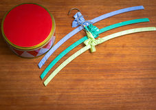 Harlequin box with colourful hangers Royalty Free Stock Photos