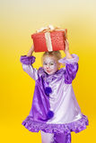 Harlequin clown with present Royalty Free Stock Photo