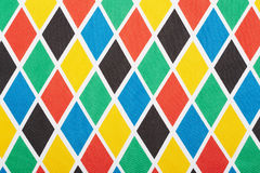 Harlequin colorful diamond fabric background Stock Images