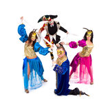 Harlequin and marionettes Stock Image