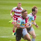 Harlequins and Gloucester Rugby. The Harlequins and Gloucester Rugby Rugby 7 S Premiership Series at Northampton Franklins Garden royalty free stock photo