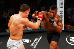 Harley Beekman throws a punch at Brennan Ward. MMA fighter Harley Beekman throws a punch at opponent Brennan Ward stock photo