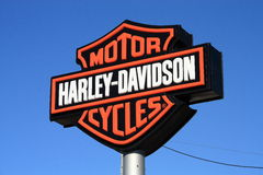 Harley-Davidson. Harley Davidson logo sign on blue sky background Royalty Free Stock Image