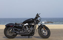 Harley Davidson at the beach. Custom made Harley Davidson on a beach deck royalty free stock image
