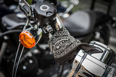 Harley-Davidson bike detail with scarf on the motors wheel. Harley-Davidson bike detailwith scarf black and white design Stock Photos