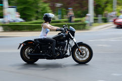 Harley-Davidson Eleven Bike Fest. WROCLAW, POLAND - MAY 21: Unidentified female motorcyclist rides motor during Harley-Davidson parade. Few thousands Stock Image
