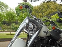 Harley davidson front forks tank saddle handle bars. Photo of an american harley davidson superbike motorcycle with twin exhaust pipes and 114 cubic inch v-twin stock photos