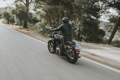 Malaga, Spain - July 15, 2018: Man riding his Harley Davidson motorcycle during a journey trip around Malaga roads in Spain stock photo