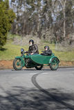 1923 Harley Davidson J Motorcycle with sidecar on country road. Adelaide, Australia - September 25, 2016: Vintage 1923 Harley Davidson J Motorcycle with sidecar Stock Photography