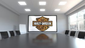 Harley-Davidson logo on the screen in a meeting room. Editorial 3D rendering. Harley-Davidson logo on the screen in a meeting room. Editorial 3D Royalty Free Stock Image