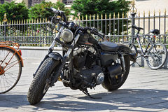 Harley-Davidson motorcycle. A snapshot with a Harley-Davidson motorcycle parked on the sidewalk Royalty Free Stock Photos