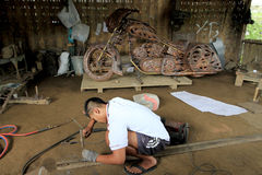 Harley davidson replica. Craftsmen are making a replica harley davidson motorcycles  from copper in Boyolali, Central Java, Indonesia Royalty Free Stock Images