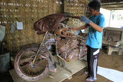 Harley davidson replica. Craftsmen are making a replica harley davidson motorcycles  from copper in Boyolali, Central Java, Indonesia Royalty Free Stock Image