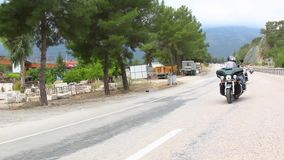 Harley Davidson riders motorcycle trip. On the road. Harley Davidson motorcycle trip. On the road stock video footage