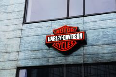 Harley Davidson sign board with brand logo. On showroom facade, closeup royalty free stock images