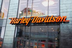 Harley Davidson sign board with brand logo on showroom facade. Closeup royalty free stock images