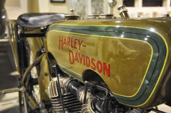Harley-Davidson VINTAGE motorcycle AND LOGO IN MUEIUM. PESARO -ITALY - NOV. 2016: Harley-Davidson VINTAGE motorcycle AND LOGO IN MUEIUM Royalty Free Stock Photography