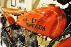 Harley-Davidson VINTAGE motorcycle AND LOGO IN MUSEUM. PESARO -ITALY - NOV. 2016: Harley-Davidson VINTAGE motorcycle AND LOGO IN MUSEUM Royalty Free Stock Photography