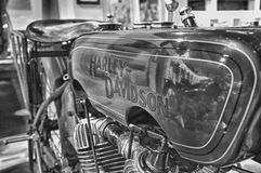 Harley-Davidson VINTAGE motorcycle AND LOGO IN MUSEUM. PESARO -ITALY - NOV. 2016: Harley-Davidson VINTAGE motorcycle AND LOGO IN MUSEUM Royalty Free Stock Photos