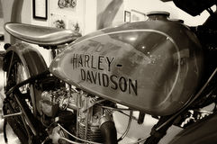 Harley-Davidson VINTAGE motorcycle AND LOGO IN MUSEUM. PESARO -ITALY - NOV. 2016: Harley-Davidson VINTAGE motorcycle AND LOGO IN MUSEUM Stock Photos