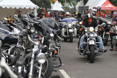 Harley lovers gather. Thousands of Harley lovers gathered together to hold the event in Yogyakarta, Indonesia. Gather together to establish communication and Stock Photos