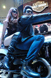 Harley motor bike with model Royalty Free Stock Photo