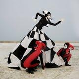 Harleyquins e regina di scacchi Fotografie Stock Libere da Diritti