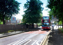 Harlington Village. London bus leaving the village of Harlington near Heathrow airport.  This village may disappear if the proposed expansion of Heathrow goes Stock Photography