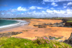 Harlyn Bay beach North Cornwall England UK near Padstow and Newquay in colourful HDR with cloudscape Royalty Free Stock Photo