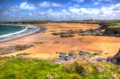 Harlyn Bay beach North Cornwall England UK near Padstow and Newquay in colourful HDR with cloudscape Stock Photos