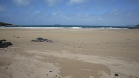 Harlyn Bay beach North Cornwall England UK near Padstow and Newquay PAN. Harlyn Bay beach North Cornwall England UK near Padstow and Newquay in spring with blue stock video