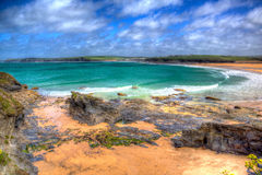 Harlyn Bay North Cornwall England UK near Padstow and Newquay in colourful HDR with cloudscape Royalty Free Stock Photos