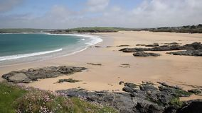 Harlyn Bay North Cornwall England UK near Padstow and Newquay PAN. View of Harlyn Bay beach North Cornwall England UK near Padstow and Newquay in spring with stock footage