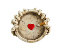 Harm from smoking. The concept of the dangers of smoking. Butt in the ashtray and the heart Stock Photo