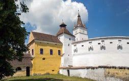 Harman筑了堡垒于教会, Transylvania,罗马尼亚 库存照片