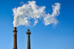 Harmful emissions into the atmosphere from industry. Greenhouse gases and glabal warming royalty free stock photography