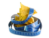 Harmful food. Corn chips wrapped in blue meter Stock Photography