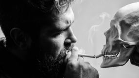 Harmful habits. Destroy your health. Smoking is harmful. Habit to smoke tobacco bring harm to your body. Smoking cause. Health damage and death. Man smoking royalty free stock photos