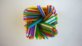 Harmful usage of colorful plastic straws in yellow box, environmental pollution. Stock footage stock video