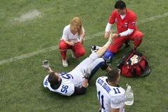 Harmonia de futebol americano entre lobos e o dragão azul Fotografia de Stock