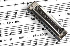 Harmonic. On a score background Stock Photo