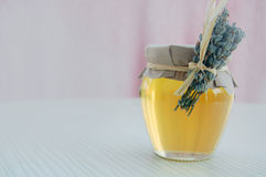 Harmonic background with lavender honey in jar Royalty Free Stock Images