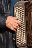 Harmonica 01. Old man plays retro accordion Stock Photo